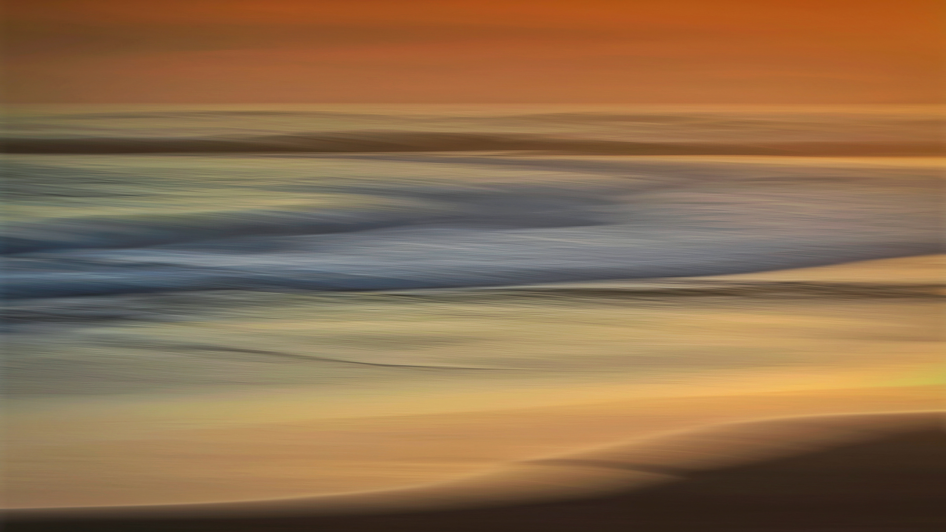 Sunset colours of a sea in motion