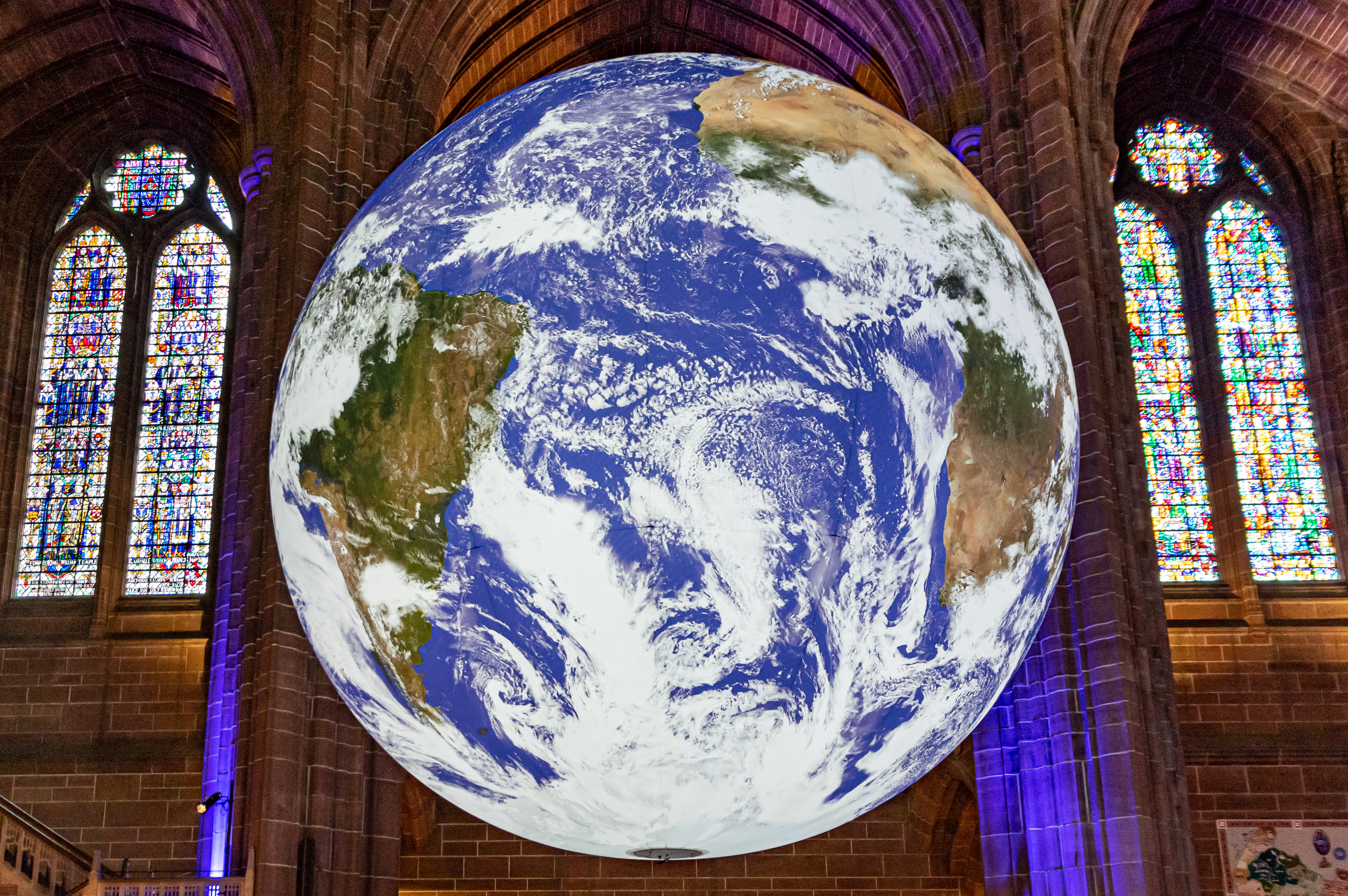 Artist Luke Jerram's Gaia installation at Liverpool's Anglican Cathedral slowly rotates accompanied by music and a commentary by Sir Richard Attenborough.