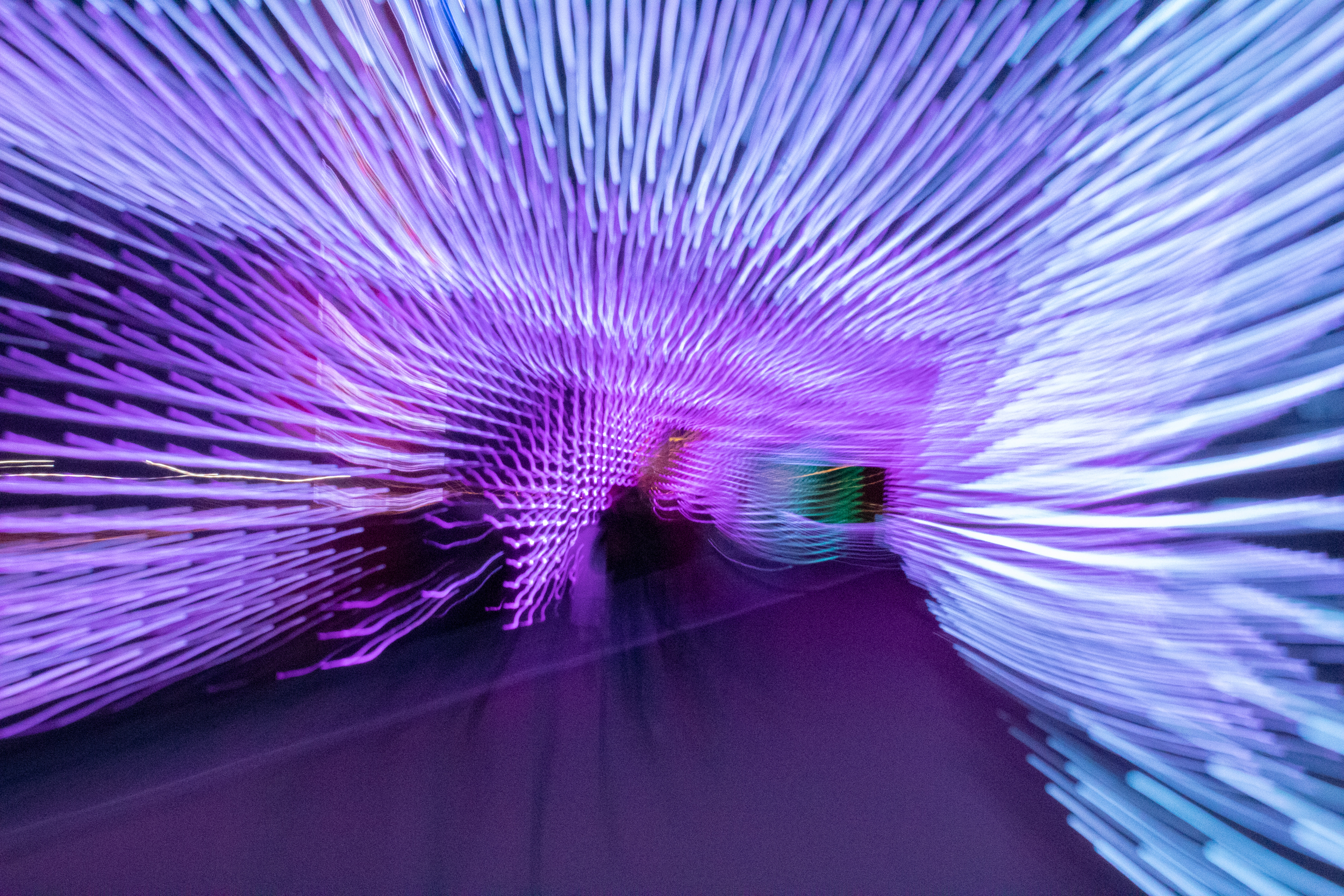 A tunnel full of lights can create motion if you set a low shutter speed and move around.