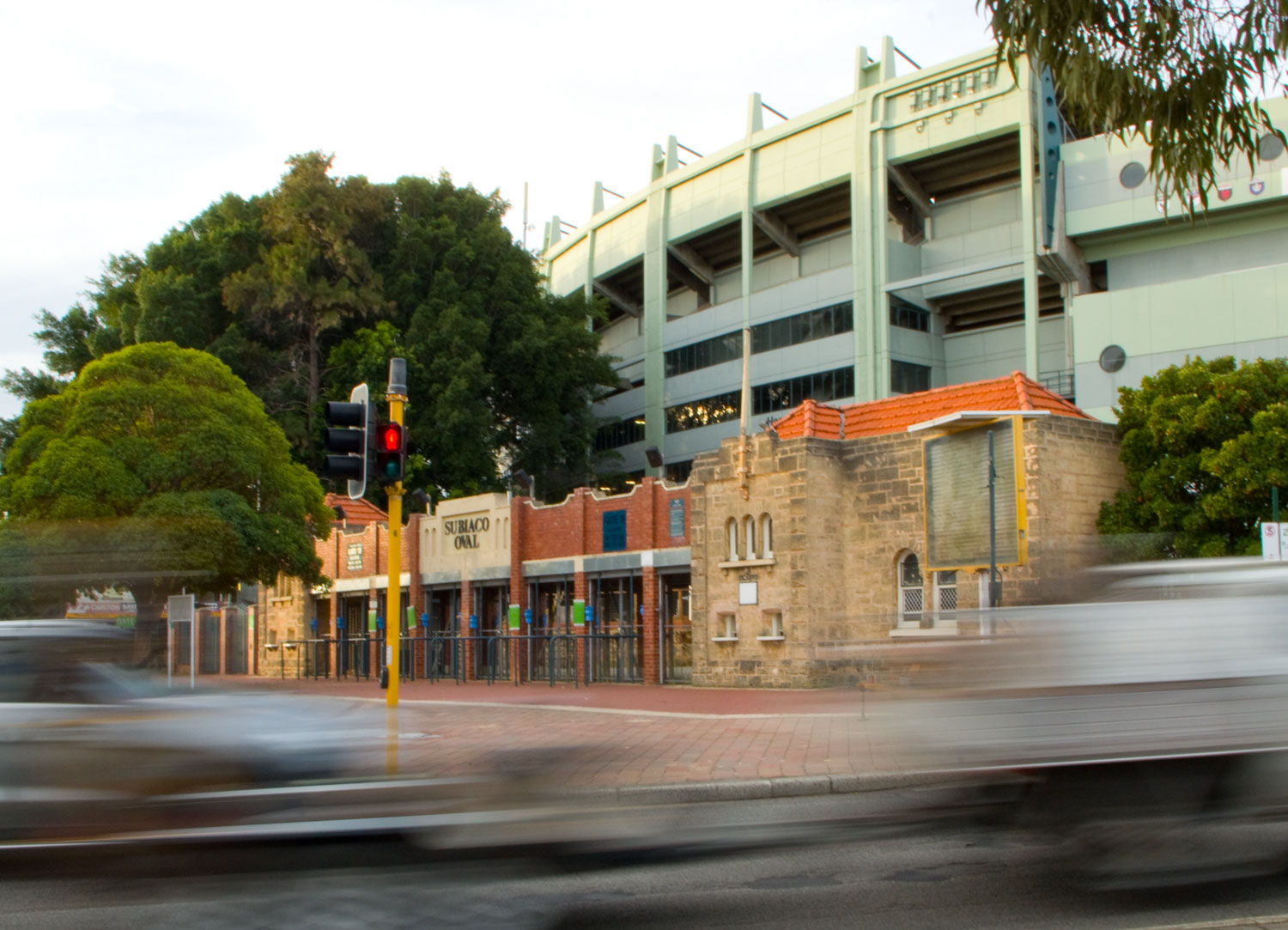 Time Goes By - a picture of the old ticket stalls entry to Subiaco Oval, with the more modern - and shortly to be demolished-  stadium at the rear