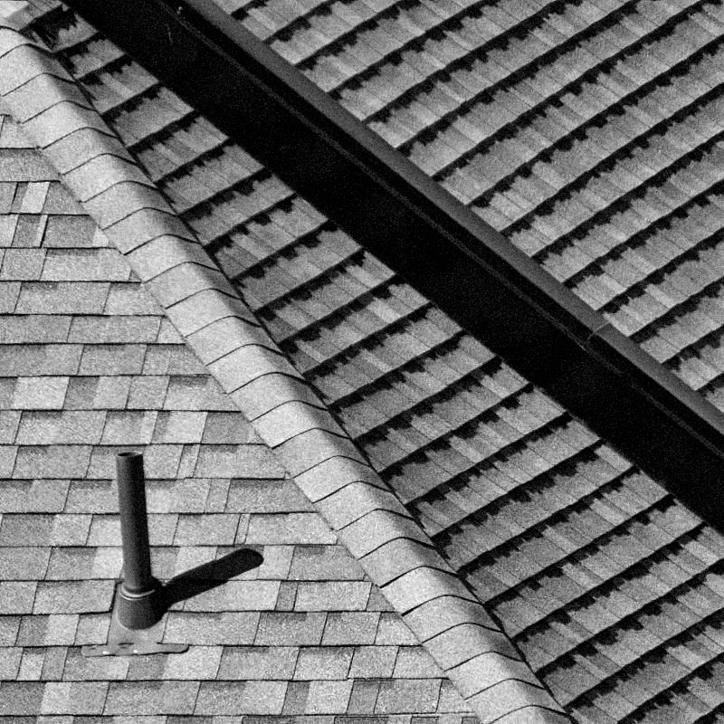 A nearby roof with 55-210mm Sony and Sony Ar7ii